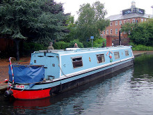 Birmingham, Narrowboat moored by the National Indoor Arena, West Midlands © Roger Kidd